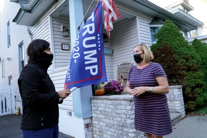 Republican New York state Assemblywoman Nicole Malliotakis, left, talks to President Donald Trump supporter Jill Keane while drumming up votes on the Staten Island borough of New York on Thursday, Oct. 8, 2020. Malliotakis is seeking to unseat U.S. Rep. Max Rose, D-N.Y., a 33 year-old Army veteran who served in Afghanistan, in New York's 11th Congressional District, a swing district, in the Nov. 3 general election.