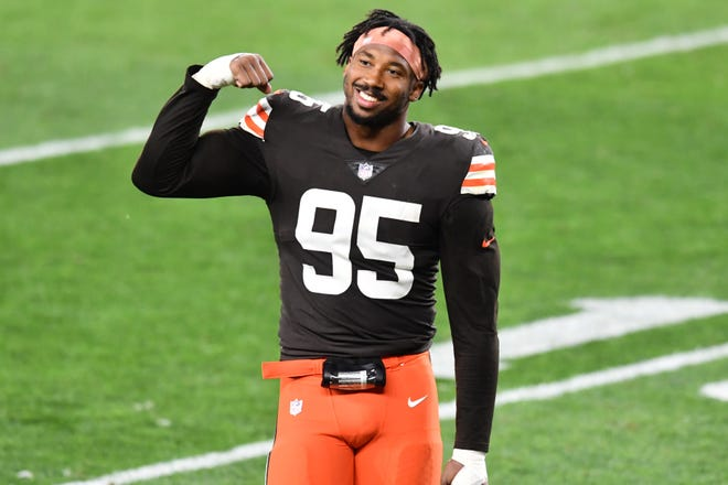 Browns defensive end Myles Garrett flexes his muscle after a victory.