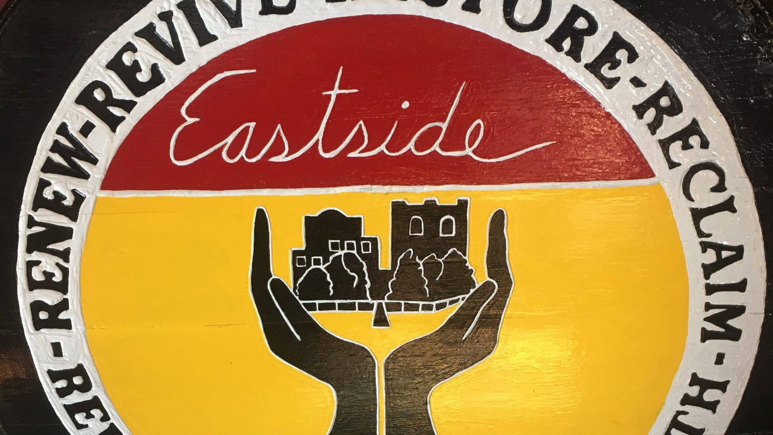 A shield of arms on display at Gladiator's Gym explains the tenants behind Garry Raymond's Eastside Renaissance.