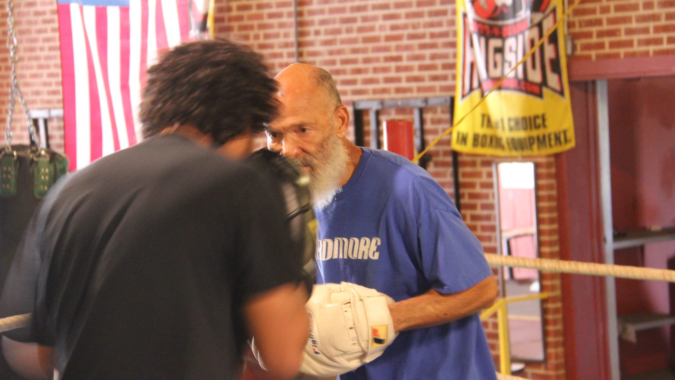 Garry Raymond instructs Kyler Hesterduring a recent training session.