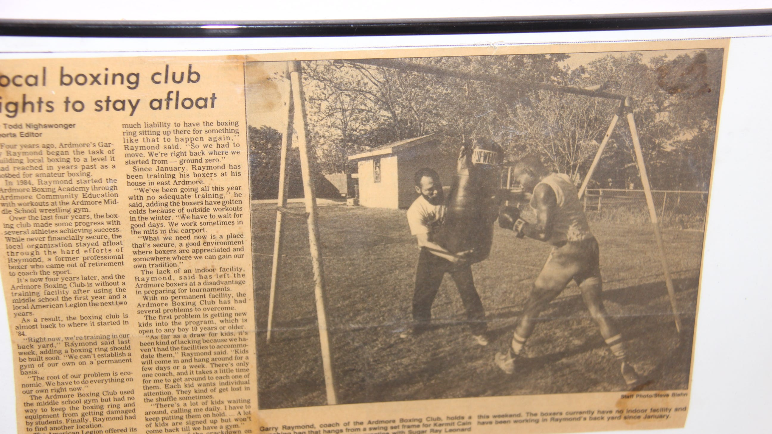 Late 1980s Press clippings from The Daily Ardmoreite show Garry Raymond training Ardmore boxer Kerrmit Cain. In 1987, Cain became first Oklahoma Golden Gloves boxer to make a national tournament since 1952.
