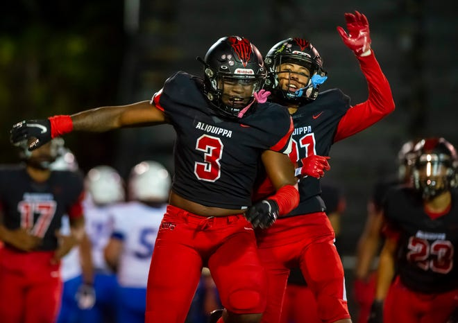 Aliquippa's Karl McBride (3) celebrates a defensive stop against Chartiers Valley with a teammate Friday night.