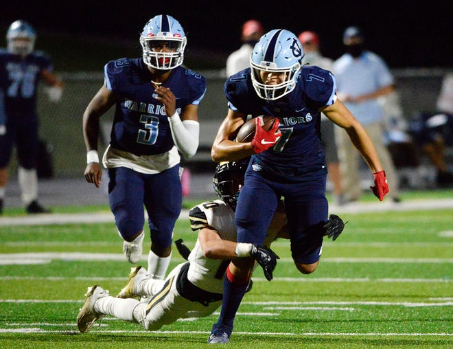 Keystone Oaks' Mark Hutchin tackles Central Valley's Jayvin Thompson during Friday night's game at Central Valley High School.