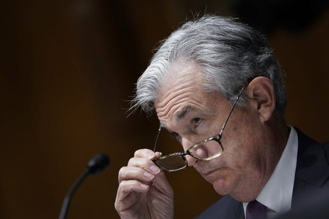 Federal Reserve Board Chairman Jerome Powell testifies during a Senate Banking Committee hearing about the CARES Act and the economic effects of the coronavirus pandemic.