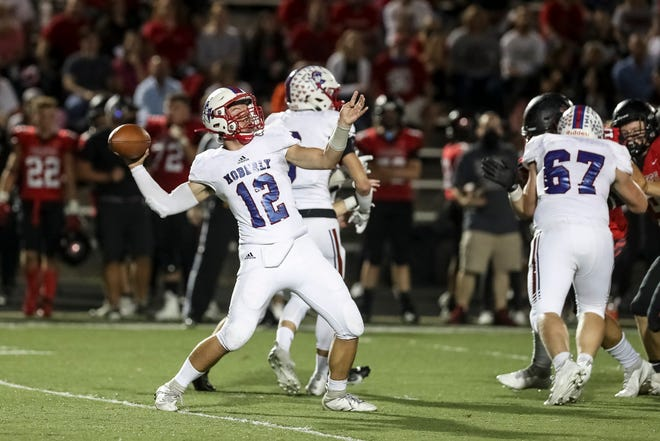 Moberly quarterback Dominic Stoneking (12) throws a pass during the Spartans' game against Hannibal on Friday night at Hannibal High School.