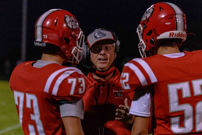 Harrisburg head football coach Steve Hopkins talks to his players during a game Sept. 18 at Harrisburg High School.