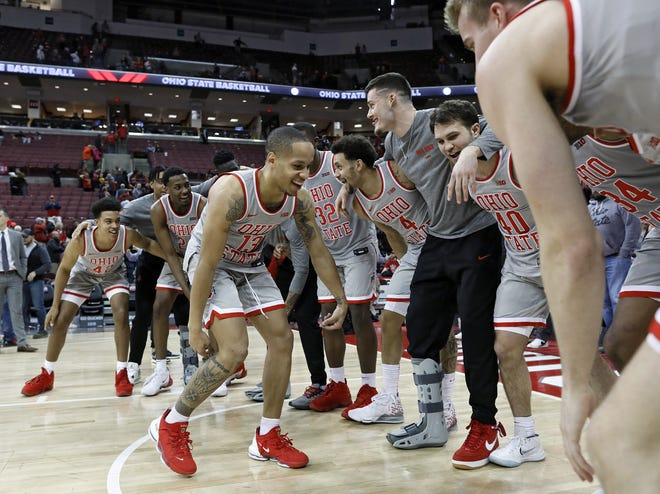 Guard CJ Walker starts a celebration dance after Ohio State beat Illinois on March 5. Walker said he's focusing on helping the Buckeyes' freshmen get ready for what likely will be a challenging season on and off the court.