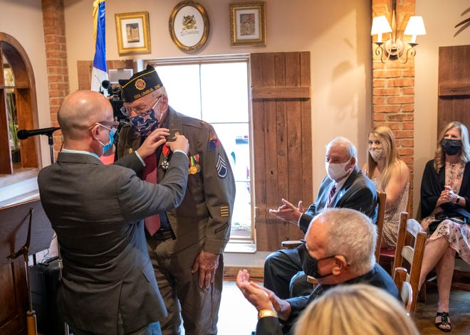 D-Day veteran Lawrence McCauley, 98,  receives the French Legion of Honor medal by Guillaume Lacroix, the consul general for France to the Midwest, Friday at La Chatelaine restaurant in Columbus.