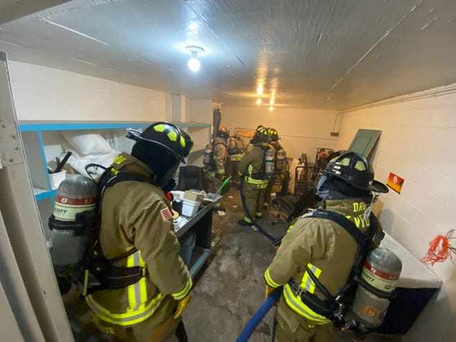 Thibodaux firefighters extinguish a fire Saturday at the Executive Inn and Suites.