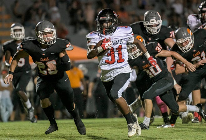 South Sumter's Jamare Dorsey (31) runs for a touchdown during Friday's game Mount Dora at Hurricanes Field in Mount Dora. [PAUL RYAN / CORRESPONDENT]