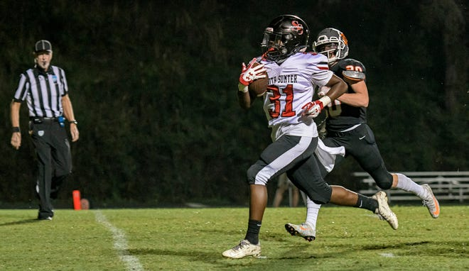 South Sumter's Jamare Dorsey (31) runs for a touchdown against Mount Dora in Friday's game at Hurricane Field in Mount Dora. South Sumter beat the Hurricanes 55-15. [PAUL RYAN / CORRESPONDENT]