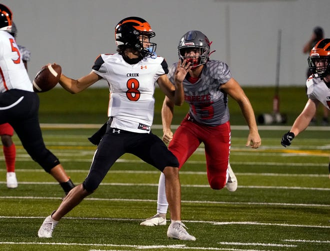 Logan Garcia (8) rushed for two touchdowns as Spruce Creek, now No. 3 in The News-Journal's power rankings, defeated Seabreeze 21-14.