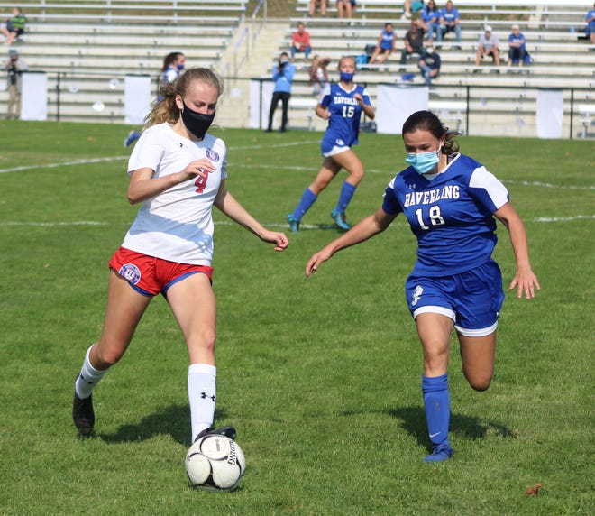 Hornell junior Tayghan Doorley  (4) controls the ball under pressure from Haverling's Kelsey Thorp Saturday morning in Bath.