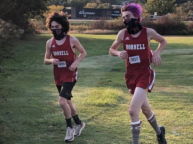 Hornell's Quinn Stillman and Collin Murphy turn the corner during Friday's cross country race against Arkport-Canaseraga.