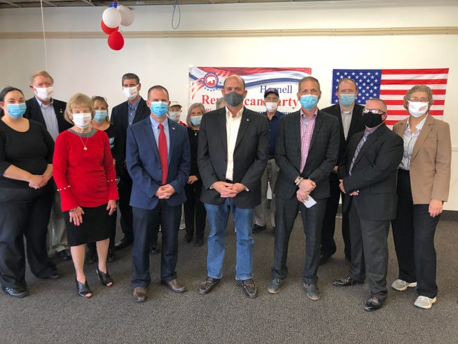 Tom Reed, center, is surrounded by local and regional Republican Party officials as he picks up the Hornell Republican Committee endorsement for his Congressional race at GOP headquarters in downtown Hornell on Thursday, Oct. 8, 2020.