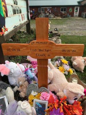 A wooden cross marking Leah Clark's memorial at Dinky Doo Petting Zoo.