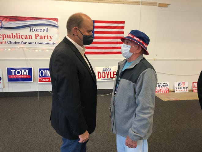 Rep. Tom Reed, R-Corning, left, talks with a constituent during at Republican Party headquarters in Hornell on Thursday, Oct. 8. Reed was in town to pick up the endorsement of the Hornell Republican Committee.
