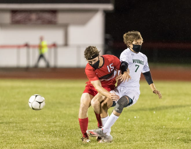 Canisteo-Greenwood's Ryder Slayton (15) and Avoca/Prattsburgh's Tucker Gerych (7) collide Thursday night in Canisteo.