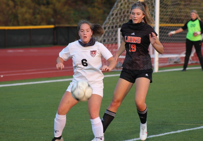 Bolivar-Richburg's McKinlee Harris (6) looks to settle the ball in front of Wellsville's Mackenzie Cowburn Friday night.