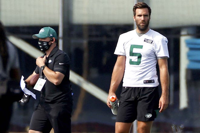 In this Aug. 22 file photo, New York Jets quarterback Joe Flacco pauses during practice at the team's training camp in Florham Park, New Jersey. Flacco is preparing this week to start against the Arizona Cardinals after a sprained shoulder sidelined Sam Darnold. [ADAM HUNGER / AP FILE]