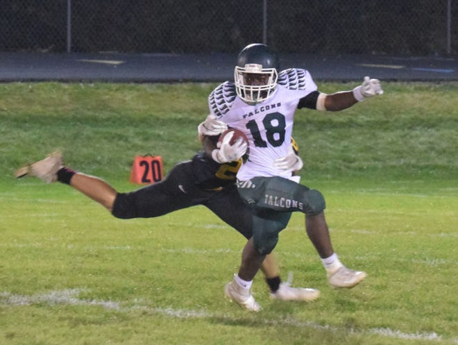 West Burlington-Notre Dame sophomore running back Travain Donaldson eludes a tackle on his way to 146 rushing yards in the Falcons/ 35-12 loss to Mid-Prairie on Friday night at Wellman.