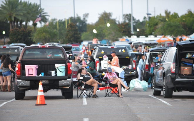 "Cars and trucks full of family and friends filled Lot J for a ""drive-in"" concert by Jon Pardi. It was Jacksonville's first popular music concert since March. Another performance is scheduled for Saturday."