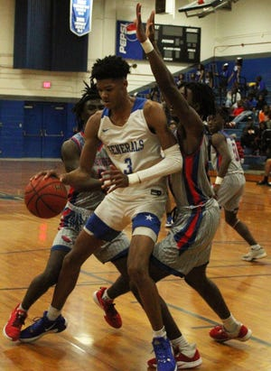 Lee junior forward Alex Fudge (3) attempts to fight through a Pensacola Pine Forest double-team in February. Fudge has committed to LSU.