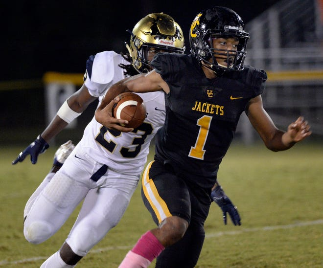 Union County played Spartanburg in high school football at Union County on Friday, Oct. 09, 2020. Union County's Desmond Herbert (1) with the ball.