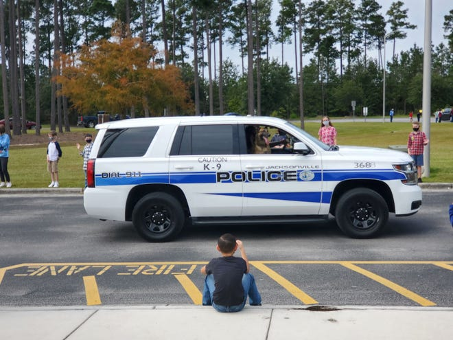 Jacksonville Public Safety held several drive-thru events with patrol cars on Friday for elementary school kids