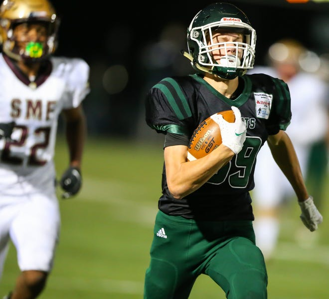 Nordonia wide receiver Matt Hayes breaks loose for a touchdown during a game against Stow-Munroe Falls earlier this season. Hayes scored a 27-yard touchdown in the Knights' 48-7 Division II playoff win at home Oct. 9 over Ashtabula Lakeside.