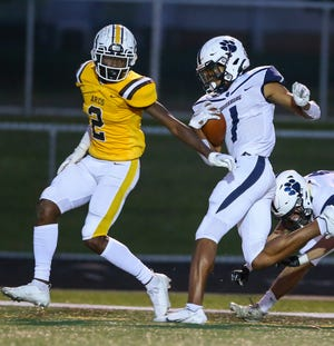 Twinsburg wide receiver Alex Branch scores one of his two touchdowns during the Tigers' 42-14 playoff win at Brush Oct. 9 in Lyndhurst.