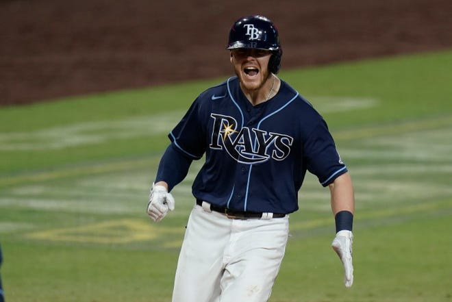 Tampa Bay Rays' Michael Brosseau celebrates after hitting a solo home run during the eighth inning in Game 5 of an American League Division Series against the New York Yankees on Friday in San Diego.