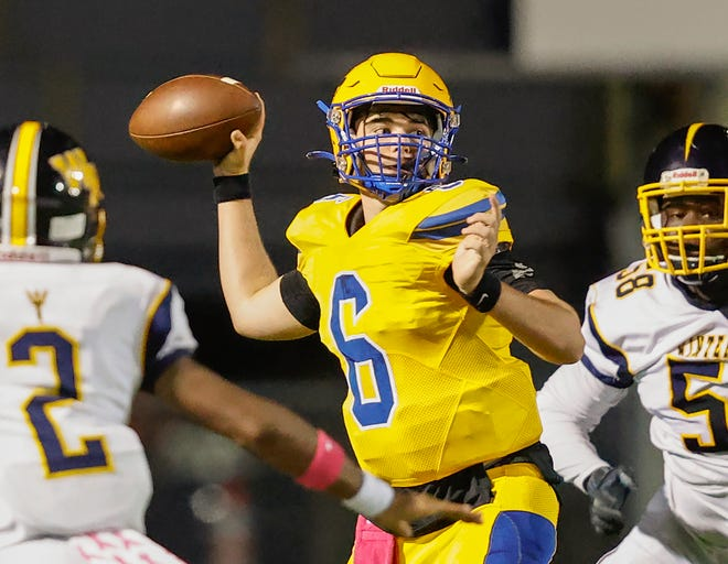 Auburndale quarterback Zach Tanner throws downfield during the game against Winter Haven at Bruce Canova Stadium in Auburndale on Friday.