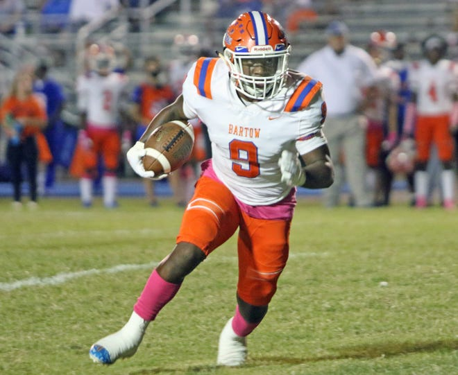 Bartow running back Amarion Baker looks to turn up field for a short gain against Kathleen during the first quarter last week at Johnny Johnson Stadium.