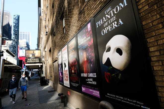 Broadway posters are displayed outside the Richard Rodgers Theatre in New York in May. Fans of Broadway will have to wait a little longer for shows to resume — until at least late May.
