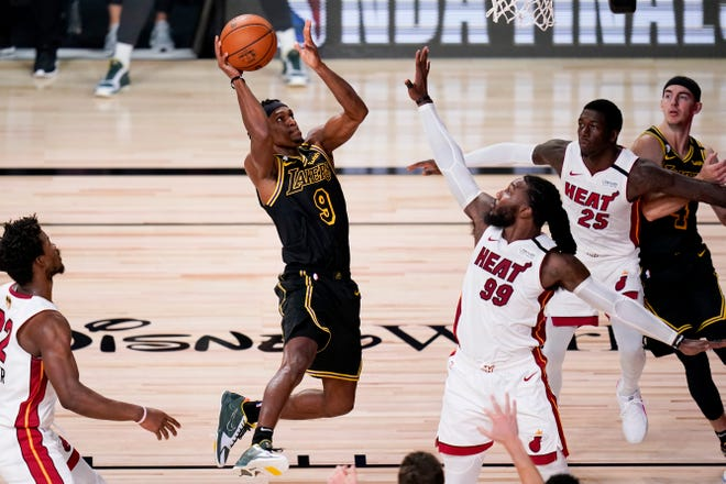 Los Angeles Lakers guard Rajon Rondo (9) shoots over Miami Heat forward Jae Crowder (99) during the second half in Game 5 of the NBA Finals on Friday in Lake Buena Vista.