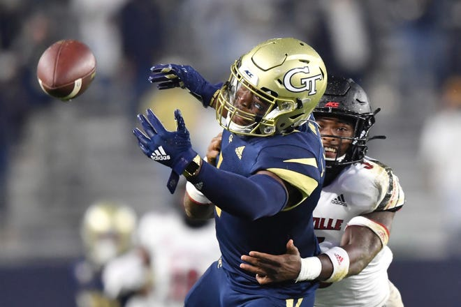 Georgia Tech wide receiver Jalen Camp (1) is not able to catch a pass under pressure from Louisville defensive back Russ Yeast during the first half of an NCAA college game Friday in Atlanta.