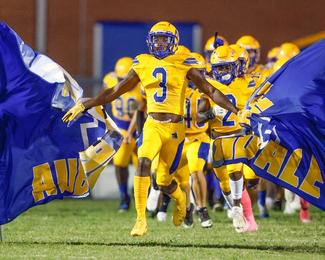Jaelen Stokes leads Auburndale on the field before its game  against Wnter Haven at Bruce Canova Stadium. The Bloodhounds surged into the Super Six rankings after knocking off the rival Blue Devils.