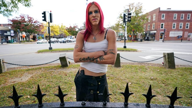 Aria DiMezzo, a Republican candidate for sheriff in Cheshire County, New Hampshire, poses at Central Square on Tuesday in Keene, N.H. Republicans in the New Hampshire county are wrestling with the fact that DiMezzo, who was nominated in last month's primary, is a transgender satanist whose campaign slogan disparages the police.