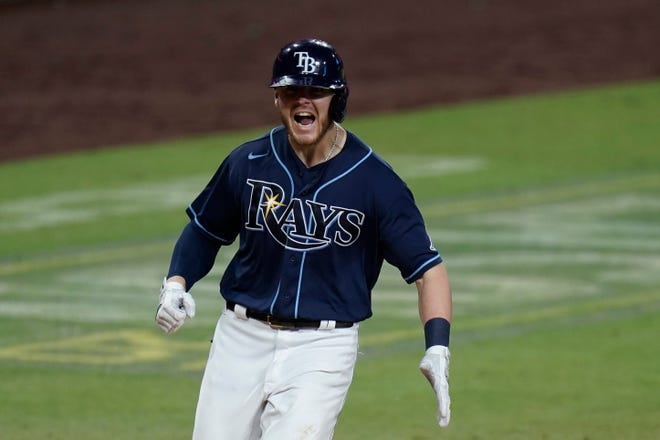 Tampa Bay's Michael Brosseau celebrates after hitting a solo home run during the eighth inning in Game 5 of the AL Division Series against the New York Yankees on Friday in San Diego.