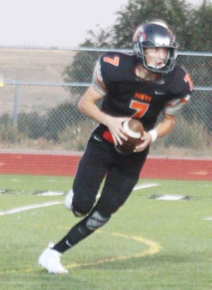 La Junta High School's Nathan Frankmore rolls out in a game against Alamosa last season. The Tigers opened the 2020 season with a 22-19 win at Englewood last Friday.