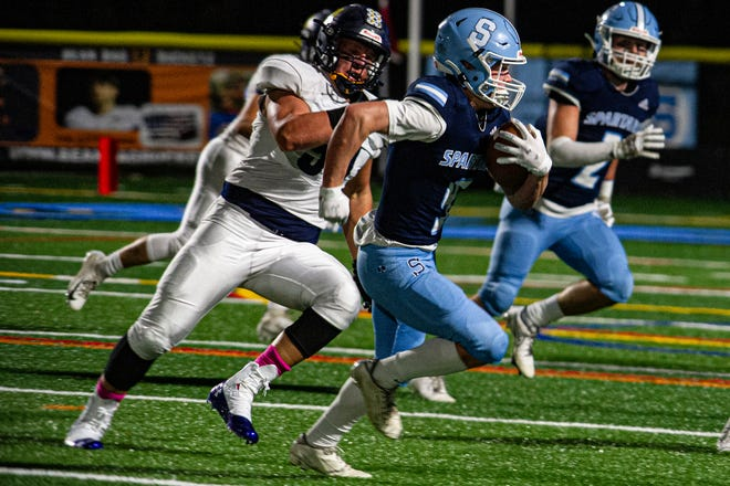 Sparta's Brendan Cina picks up big yards in the first half of the team's game against Jefferson on Oct. 9 at Sparta High School.