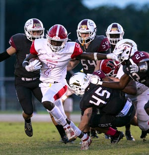 Dunnellon's Demetrius McCants breaks through the North Marion defense. The Tigers beat the Colts 32-8 Friday night.