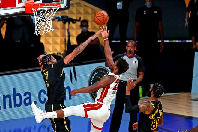 Heat forward Jimmy Butler is fouled by Lakers forward Anthony Davis with 16.8 seconds to play in Game 5 of the NBA Finals. Butler made both free throws for the winning points. [Kim Klement-USA TODAY Sports]