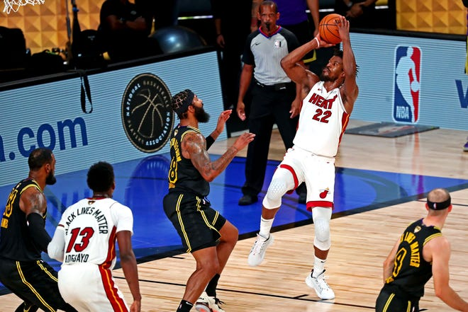 Heat forward Jimmy Butler (22) shoots the ball against Lakers forward Markieff Morris (88) during the fourth quarter in game five of the 2020 NBA Finals at AdventHealth Arena on Friday.