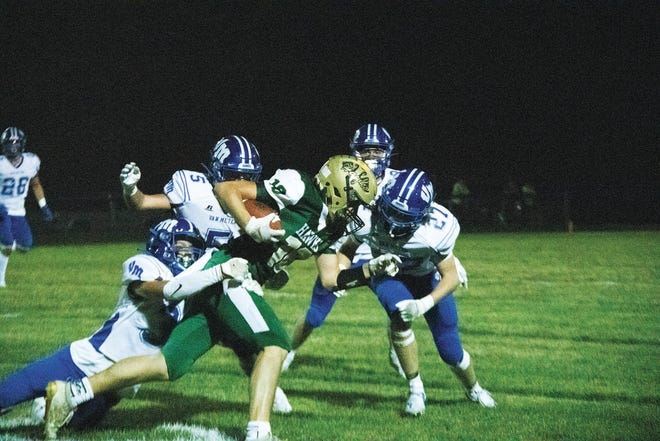 Kade Polich with a run against Van Meter on Friday, Oct. 9 in Woodward.