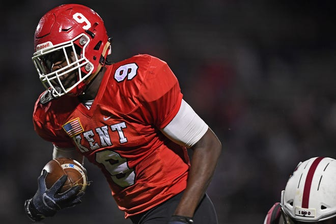 Roosevelt's Jeremiah Jones takes a fumble recovery into the end zone against University School Friday.