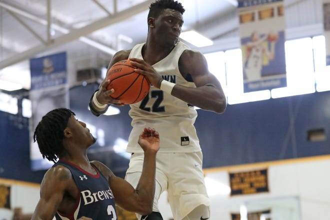 Franck Kepnang (22) of Westtown School (Pennsylvania) grabs a rebound in a Jan. 13, 2019, game against Brewster Academy in the Bronx, N.Y.