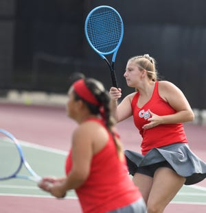 Canton South's Abigail Franks (foreground) and Destiny Wiinans compete in a girls tennis Division II doubles sectional final at Jackson North Park, Saturday, Oct. 10, 2020.