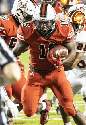 McKinley's Mani Powell takes the ball down close to the goal line during the first quarter against Berea-Midpark on Friday, Oct. 9, 2020. [Bob Rossiter/Special to The Canton Repository]
